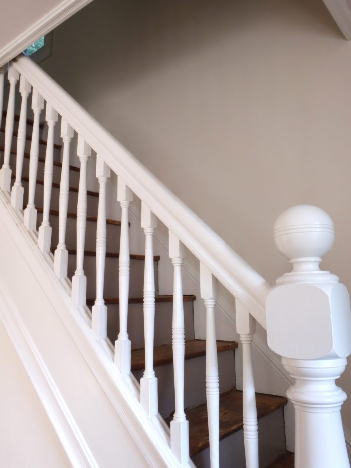 Freshly painted white stair railing