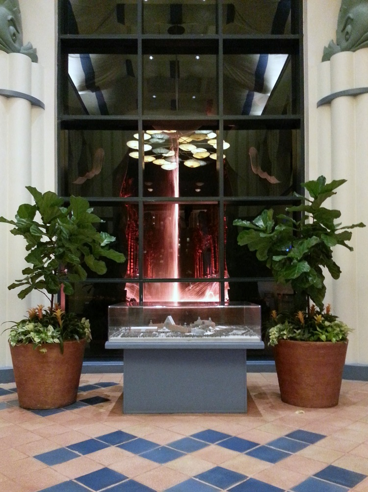 The scale model sits in front of a giant window off the lobby